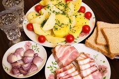 Snack to vodka. Smoked bacon with potatoes and onion - a good appetizer for a good company stock photos