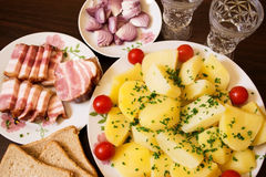 Snack to vodka. Smoked bacon with potatoes and onion - a good appetizer for a good company royalty free stock photos
