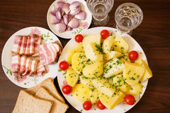 Snack to vodka. Smoked bacon with potatoes and onion - a good appetizer for a good company royalty free stock photo