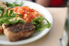 Snack. Toast with tomatoes and arugula Royalty Free Stock Images