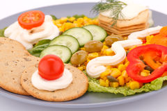 Snack with vegetables and crackers Stock Photography