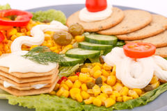Snack with vegetables and crackers. Snacks with vegetables, crackers and cheese cream on plate Stock Images