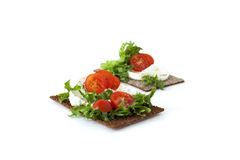 Snack from wholegrain rye crispbreads with Cherry tomatoes, salad and goat cheese. Healthy snack from wholegrain rye crispbreads crackers with Cherry tomatoes royalty free stock photos