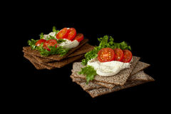 Snack from wholegrain rye crispbreads with Cherry tomatoes, salad and soft cheese. Healthy snack from wholegrain rye crispbread cracker with Cherry tomatoes Stock Images