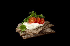 Snack from wholegrain rye crispbreads with Cherry tomatoes, salad and soft cheese. Healthy snack from wholegrain rye crispbread cracker with Cherry tomatoes stock photography
