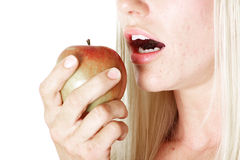 Snacking on an apple Royalty Free Stock Image