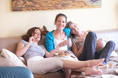 Snacks. Girls having a party in their livingroom Stock Photography