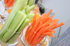 Snacks. Green cucumber and red carrots at the party Stock Image