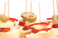 Snacks. Detail of finger foods on bright background Stock Photography