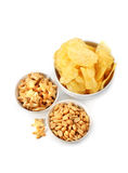 Snacks. Chips and peanuts isolated over white Royalty Free Stock Photos