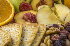 Snacks background, fruits, nuts, crackers Royalty Free Stock Image