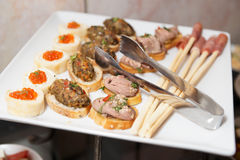 Snacks on banquet table Stock Photography