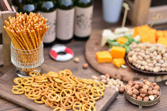 Snacks, beer and cheese, nuts Royalty Free Stock Photography