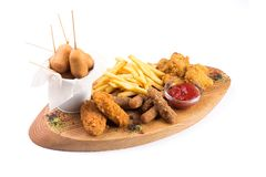 Snacks for beer on a wooden board. Isolated on a white background royalty free stock image