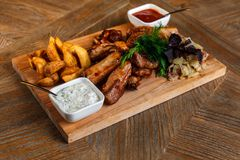 Snacks for beer are on a wooden tray. October fest.  royalty free stock images