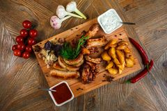 Snacks for beer are on a wooden tray. October fest.  stock photos
