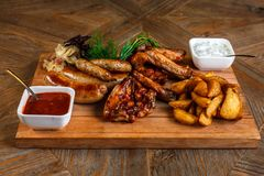 Snacks for beer are on a wooden tray. October fest.  stock image