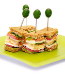 Snacks of Classical BLT Club Sandwich. Isolated on green plate Stock Photography