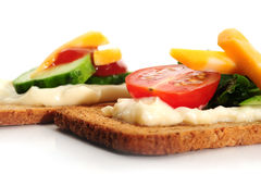 Snacks. Close-up image of crackers with some cream tomato, cucumbers and cheese Stock Image