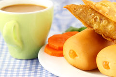 Snacks with cup of tea Stock Image