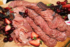 Snacks. Delicious cold cuts with crackers Royalty Free Stock Photography