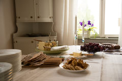 Snacks grapes and cheese on table Stock Images