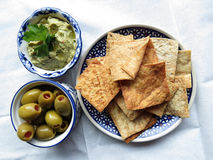 Snacks with hummus, chips and olives Royalty Free Stock Photos