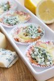 Snacks made of cheese and smoked salmon. Snacks made of cheese, blue cheese and smoked salmon Stock Photography