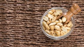 Toasted peanuts on wooden background - Arachis hypogaea. Snacks - mix of energy bars with peanut Royalty Free Stock Photos