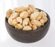 Toasted peanuts on wooden background - Arachis hypogaea. Snacks - mix of energy bars with peanut Royalty Free Stock Photo