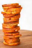Snacks with  pepper and oregano stacked on wooden board Stock Photo