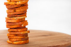 Snacks with  pepper and oregano stacked on wooden board Royalty Free Stock Photography