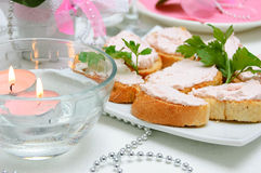 Snacks on a plate. Snacks on a white plate on the festive table Stock Images