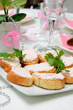 Snacks on a plate. Snacks on a white plate on the festive table Royalty Free Stock Photos
