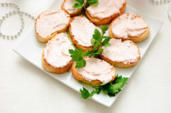 Snacks on a plate. Snacks on a white plate on the festive table Stock Photos