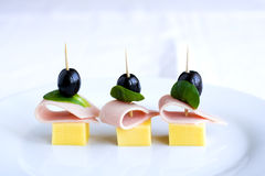 Snacks on plate. Tasty appetizer on white plate Royalty Free Stock Photos