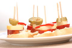 Snacks on a plate. Several finger foods with olives on a plate Royalty Free Stock Photos