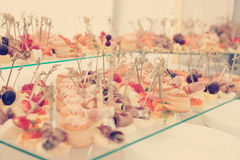 Snacks in plate on banquet table, toned image Royalty Free Stock Photography