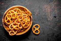 Snacks pretzels in a bowl stock images