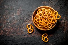Snacks pretzels in a bowl stock image