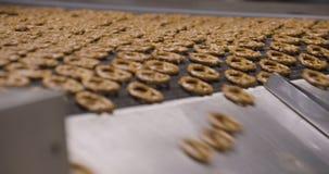 Snacks production Closeup conveyor, baked pretzel snacks