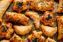 Snacks puff pastry with various fillings sprinkled with seeds Stock Photography