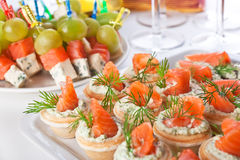 Snacks with salmon and cheese Stock Images