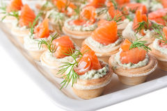 Snacks with salmon and cheese (close-up) Royalty Free Stock Images
