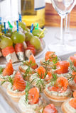 Snacks with salmon and cheese for wine Stock Photos
