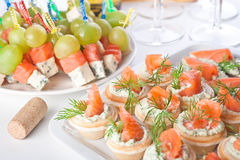 Snacks with salty salmon and cheese for wine Royalty Free Stock Photos
