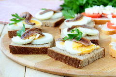 Snacks sandwiches with egg and anchovies Stock Image