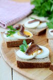 Snacks sandwiches with egg and anchovies Royalty Free Stock Images