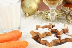 Snacks for Santa Claus and Rudolf. Christmas Eve snacks including a plate of cinnamon cookies and a glass of sherry or wine for Santa Claus and a glass of milk Stock Images