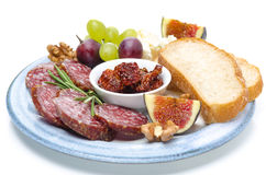 Snacks - sausage, bread, figs, grapes, nuts, dried tomatoes Stock Images